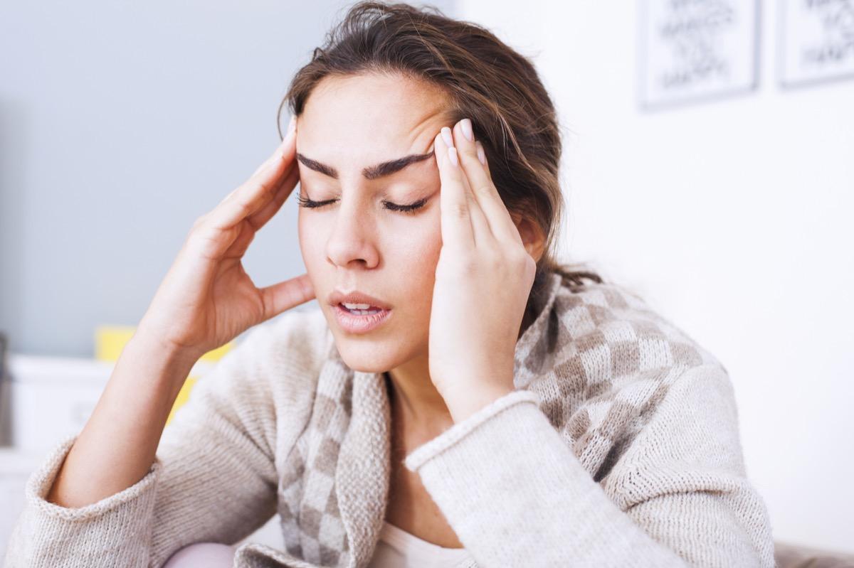 Woman waking up with headache
