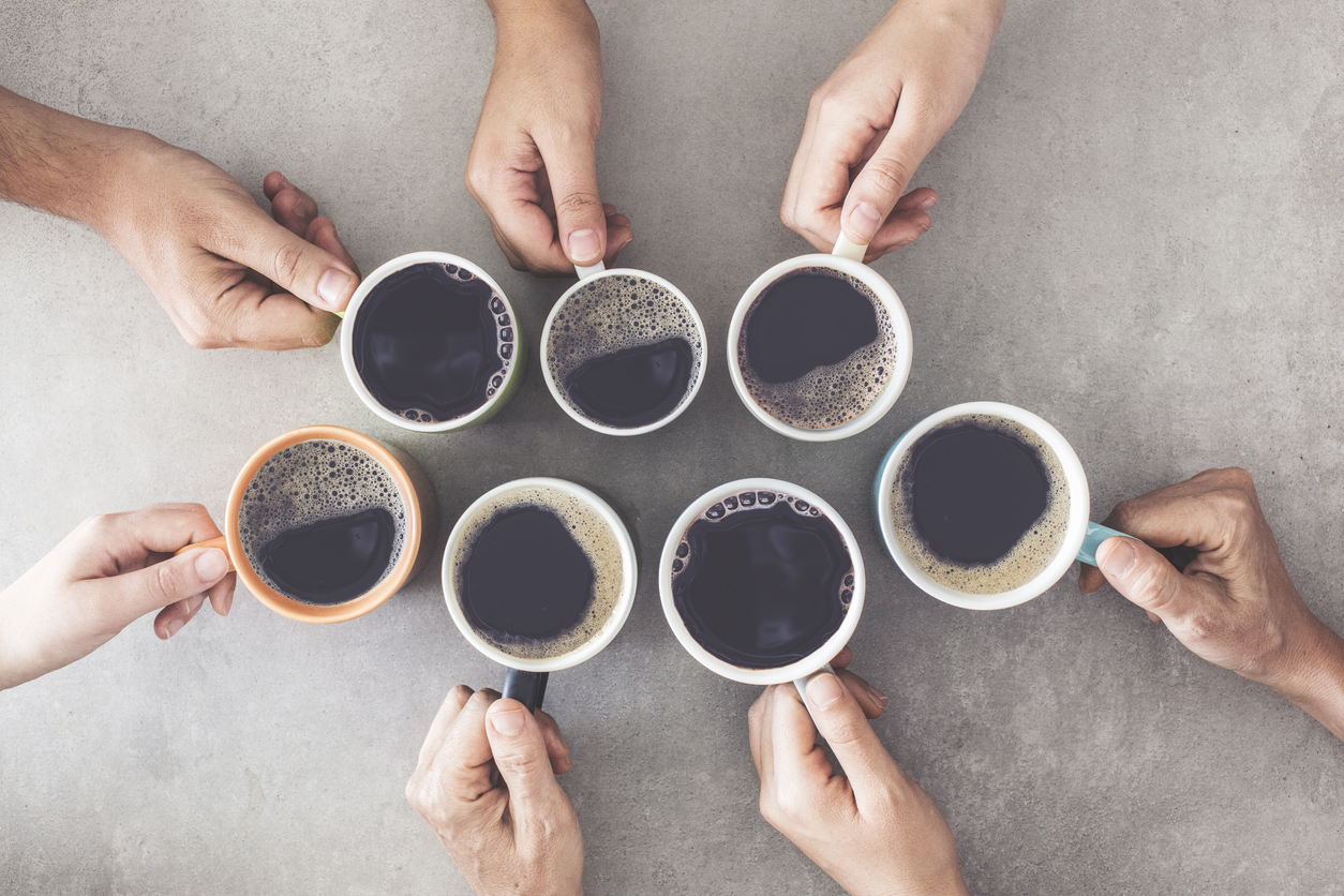 People hands holding cups of coffee
