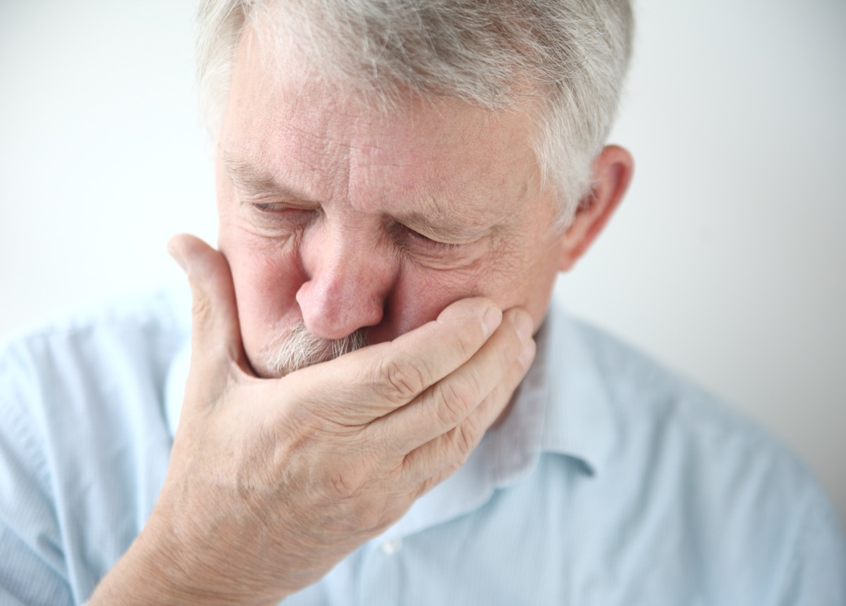 Older Man with Hand Over his Mouth Because of Nausea Surprising Symptoms