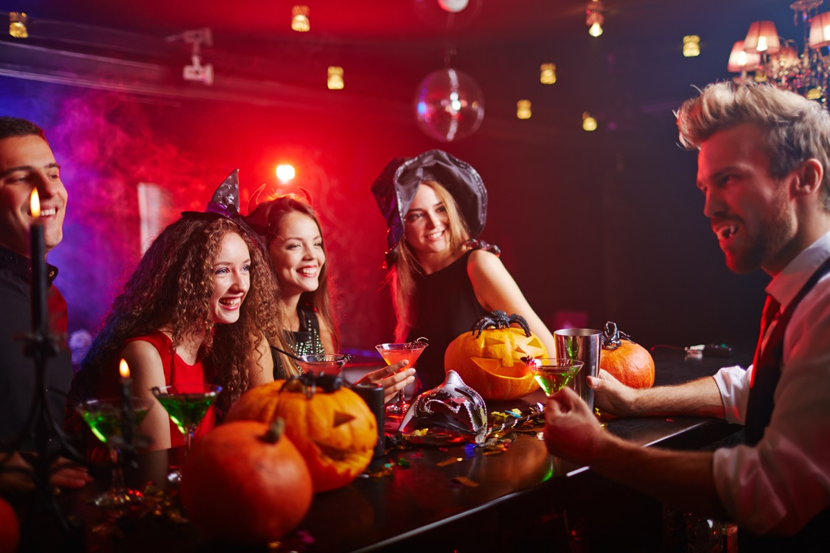 people sitting at a bar in halloween costumes things to throw away