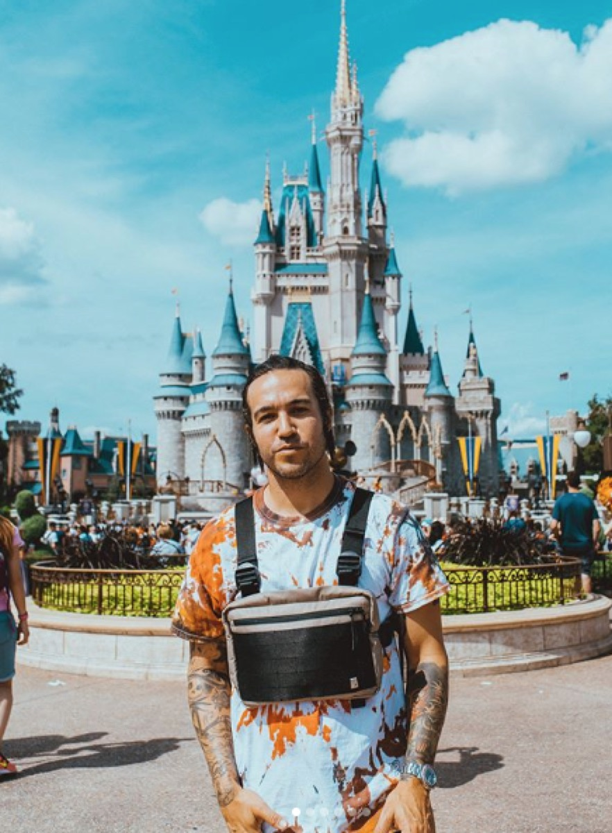 pete wentz at disney world in front of castle, disney celebs
