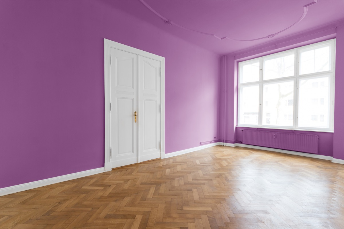 bedroom wall with purple paint all around