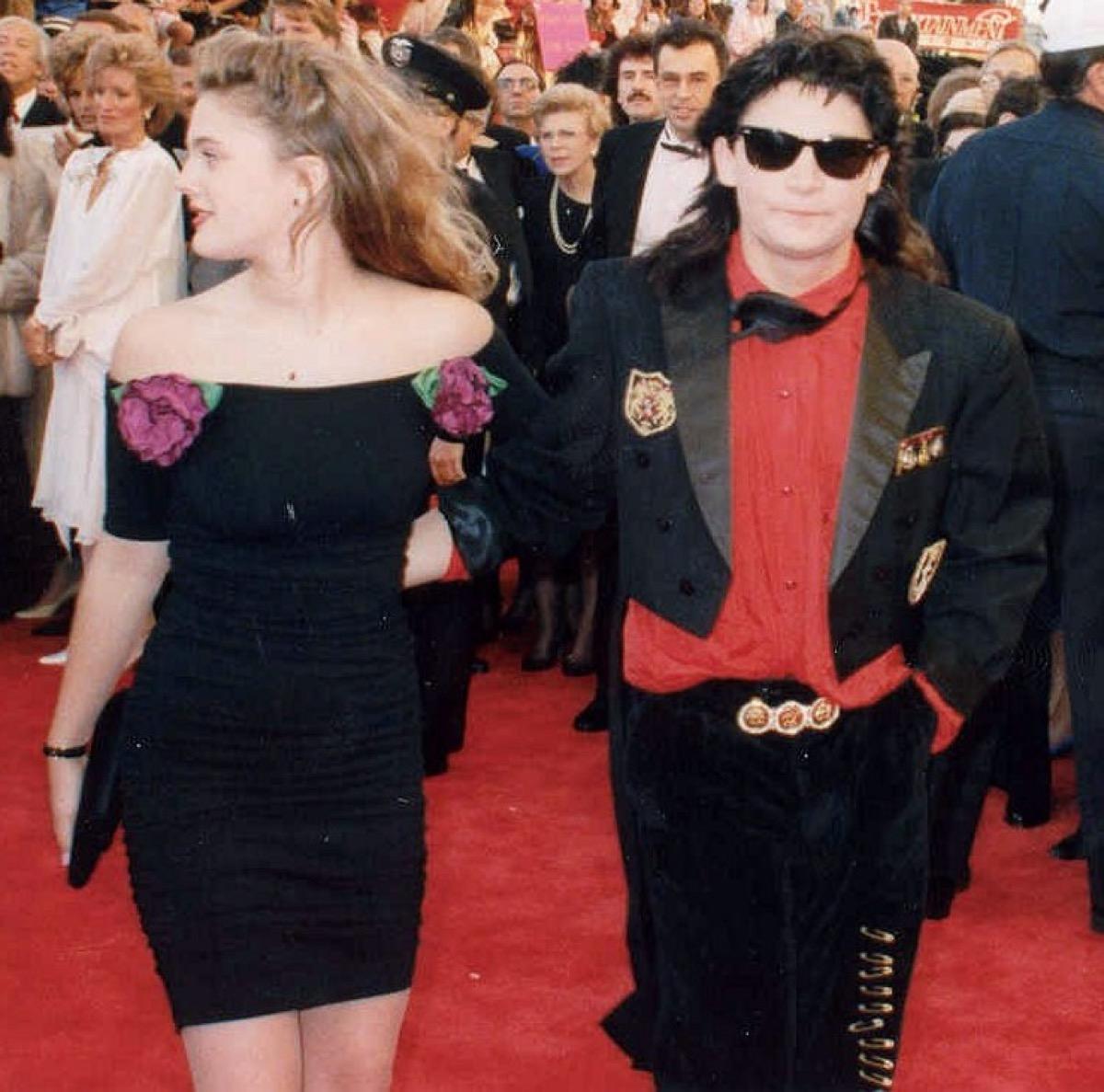 Drew Barrymore and Corey Feldman at the 61st Academy Awards, corey wearing ray ban wayfarers, 1980s fashion