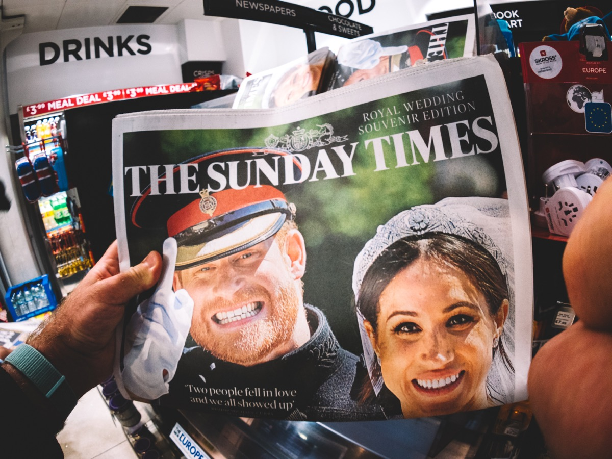 royal couple meghan and harry on front page of british newspaper, meghan markle