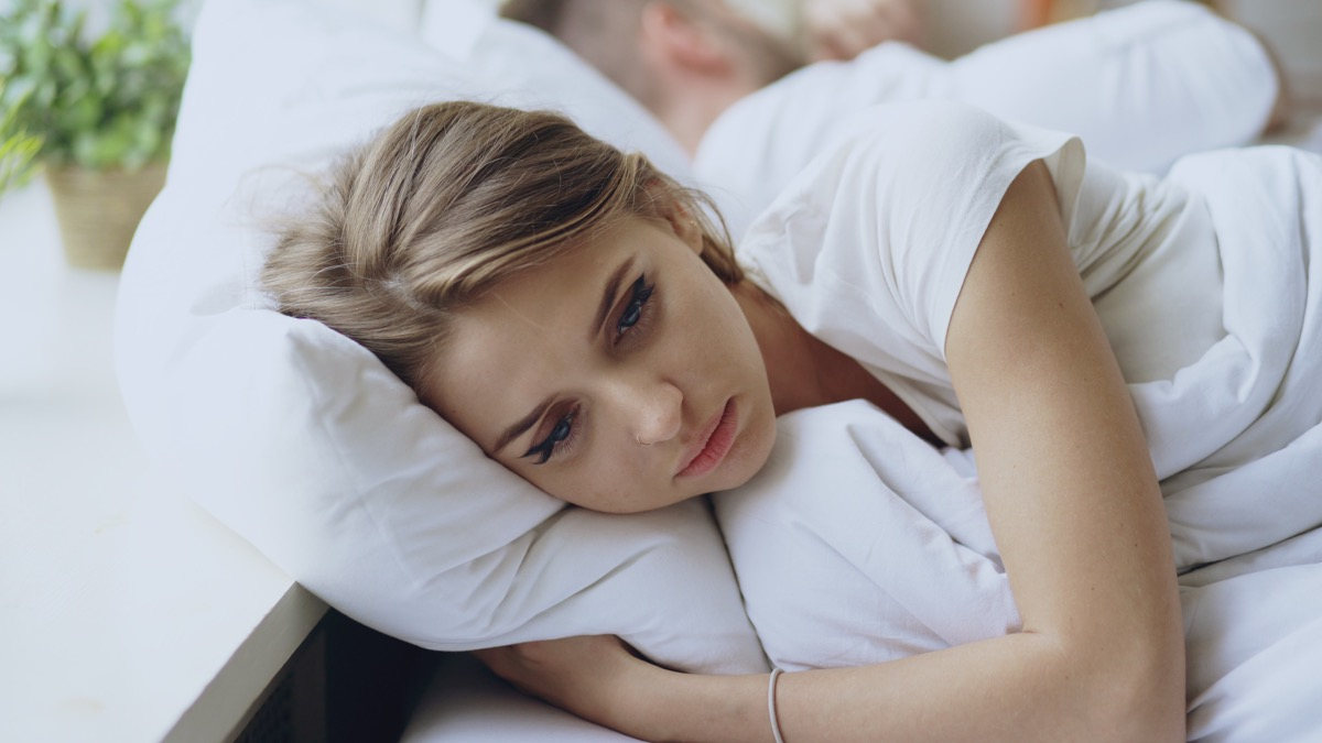 Sad Woman Lying on a Pillow