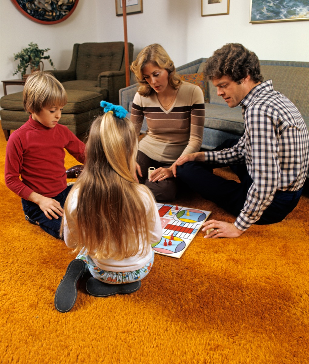Family Playing Games on Shag Carpeting 1970s Home Decor