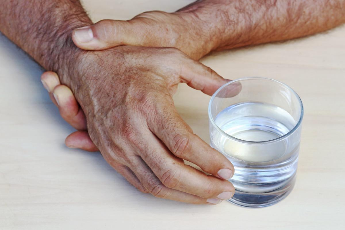 Older Person Can't Pick Up Water Because of Shaking Hands Surprising Symptoms