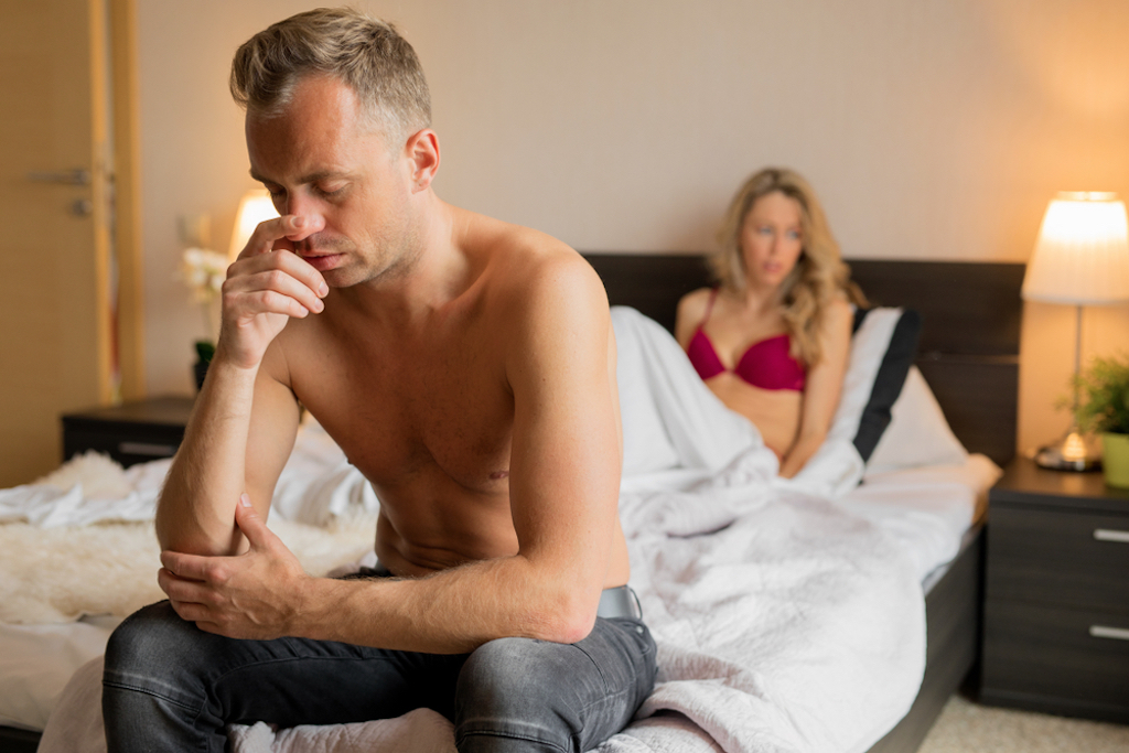 Sexually unsatisfied woman sits in bed as man mopes relationships with big age difference