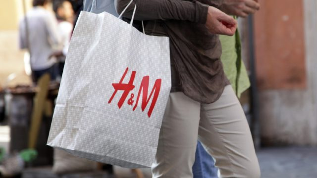 close up of h&m bag being carried by a man
