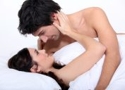 couple in bed stares lovingly into each other's eyes thanks to midnfulness