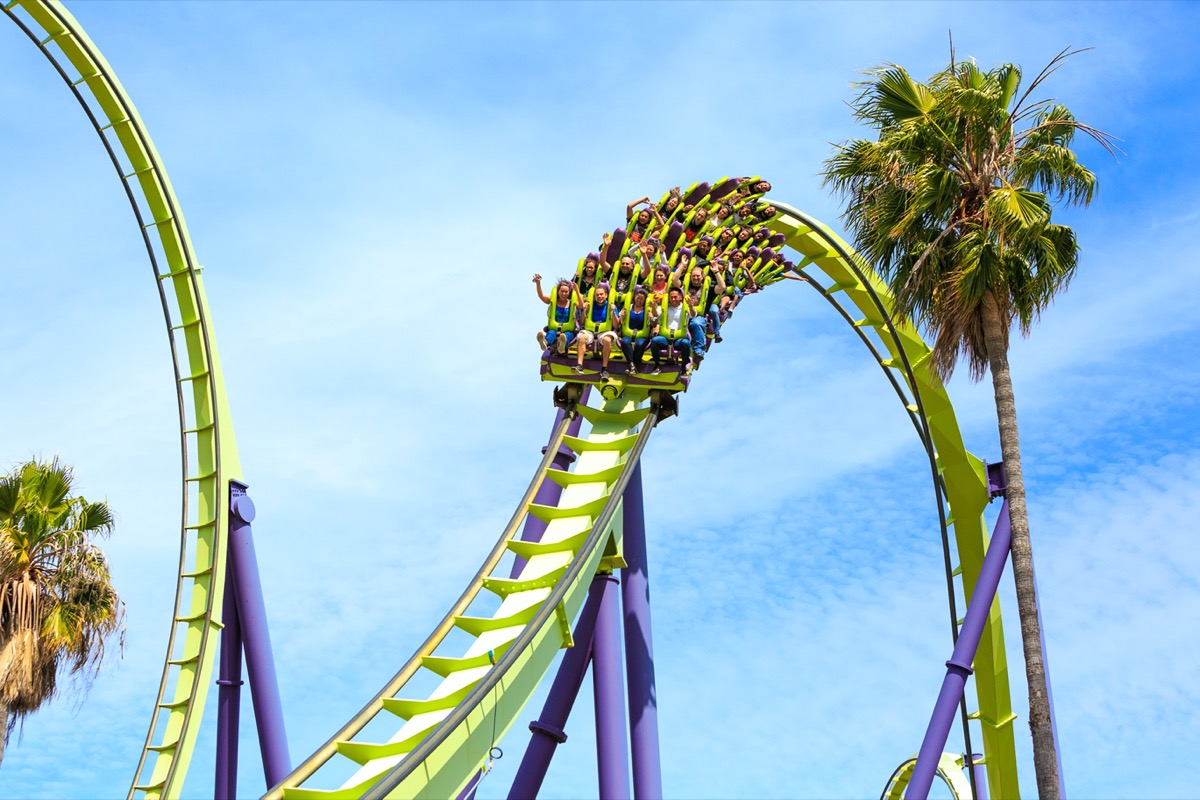 people riding rollercoaster in six flags california