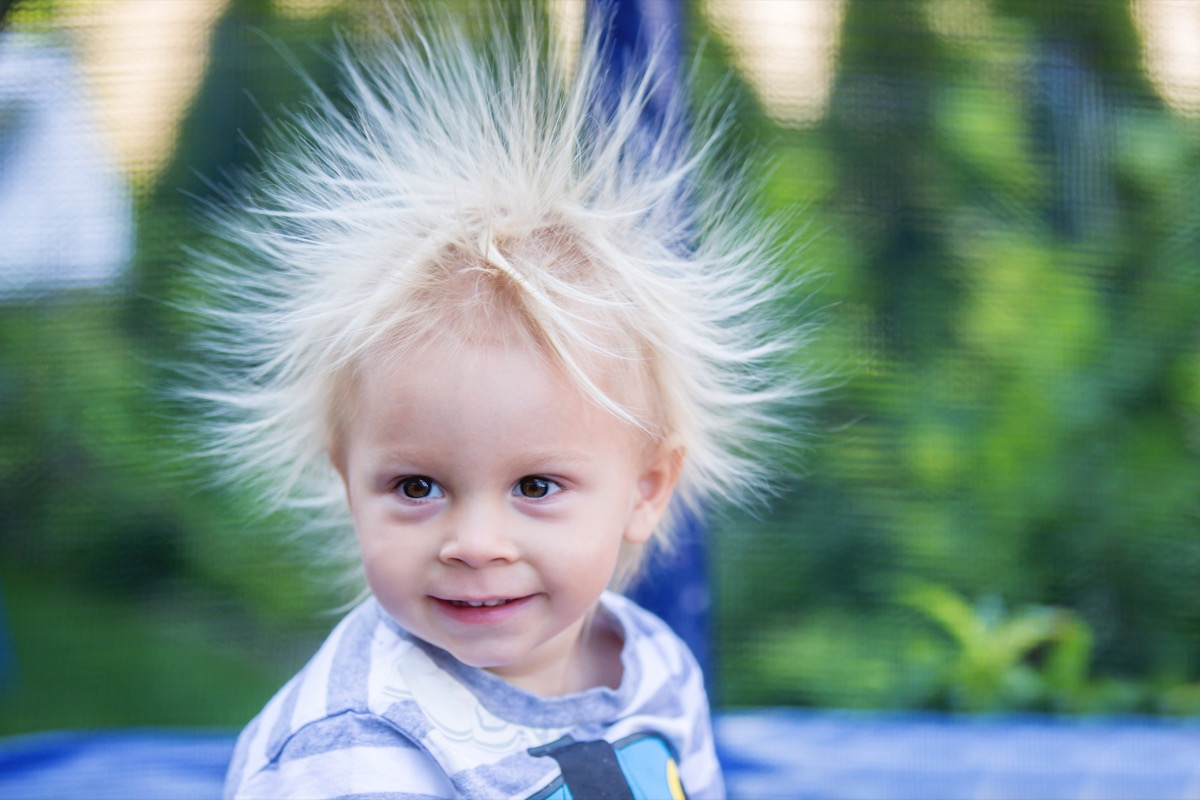 Little boy with hair standing up from static electricity