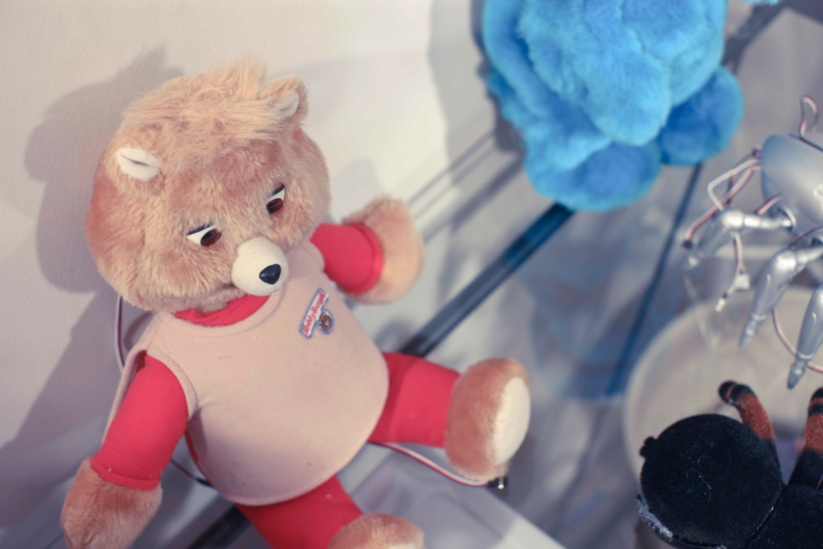 teddy ruxpin doll sitting on a counter