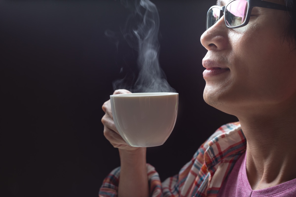 Older woman drinking tea before bed