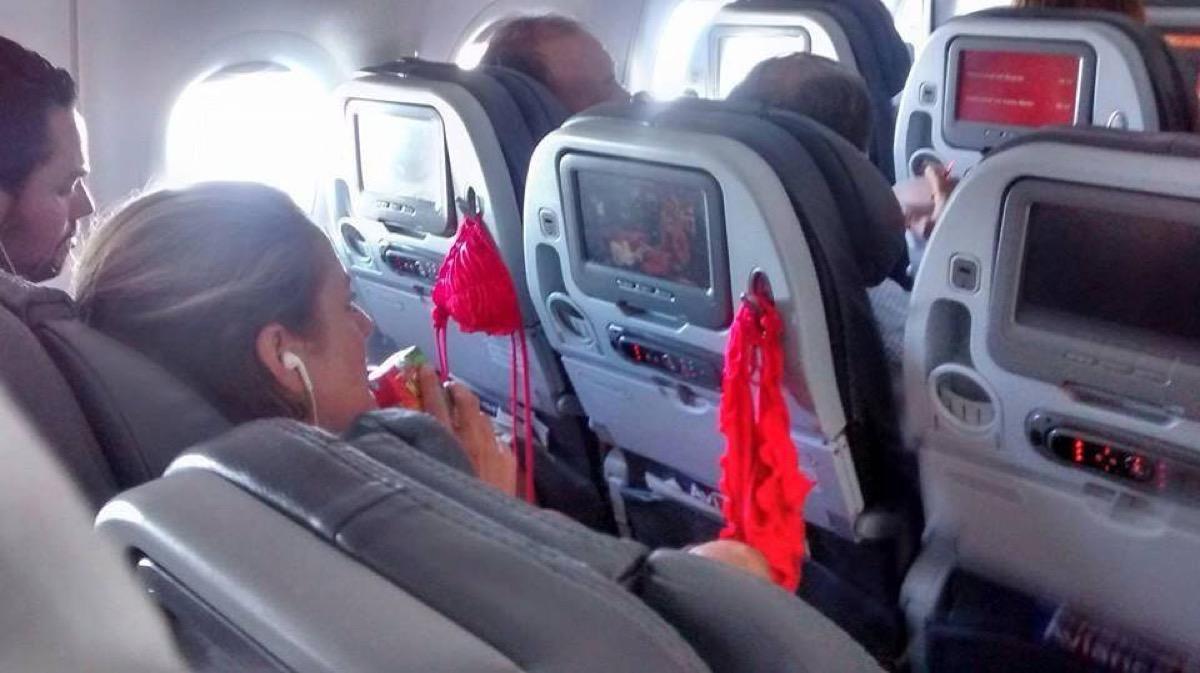 Woman drying out bikini on airplane photos of terrible airplane passengers