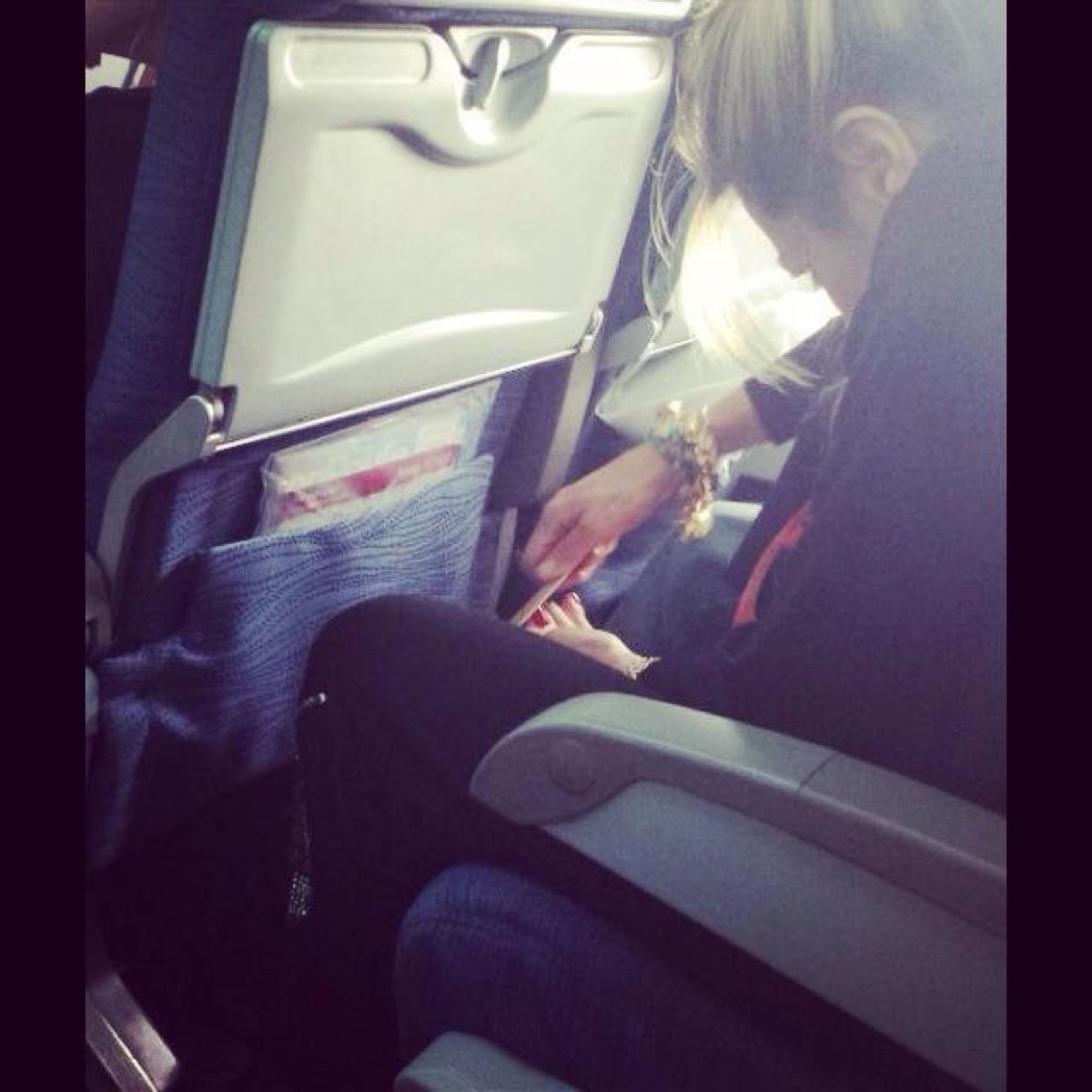 Woman filing toenails on an airplane photos of terrible airplane passengers