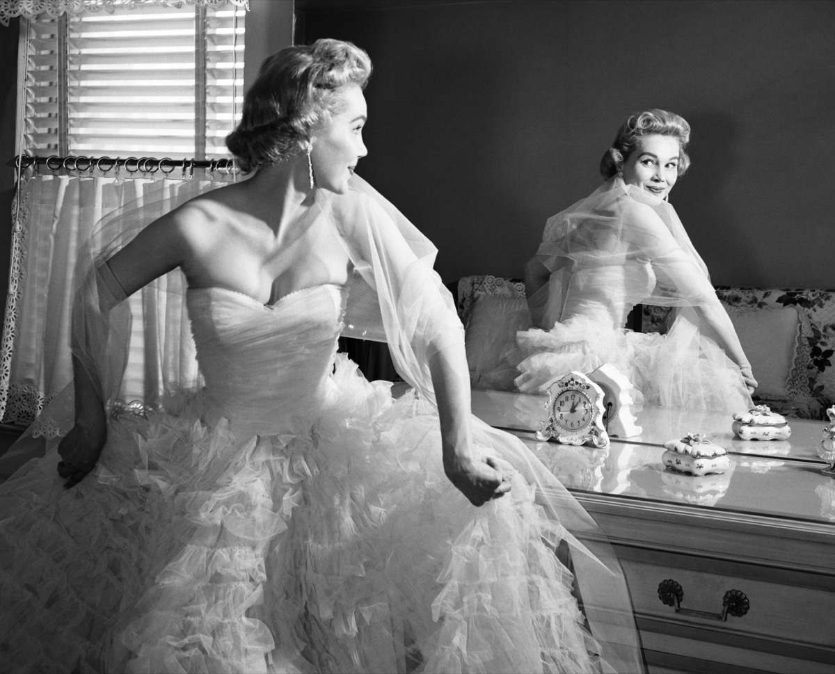 A Woman Looking in the Mirror While She Gets Ready in the 1950s