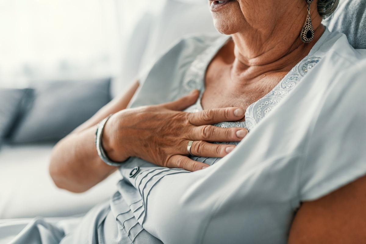 Older woman experiencing heartburn