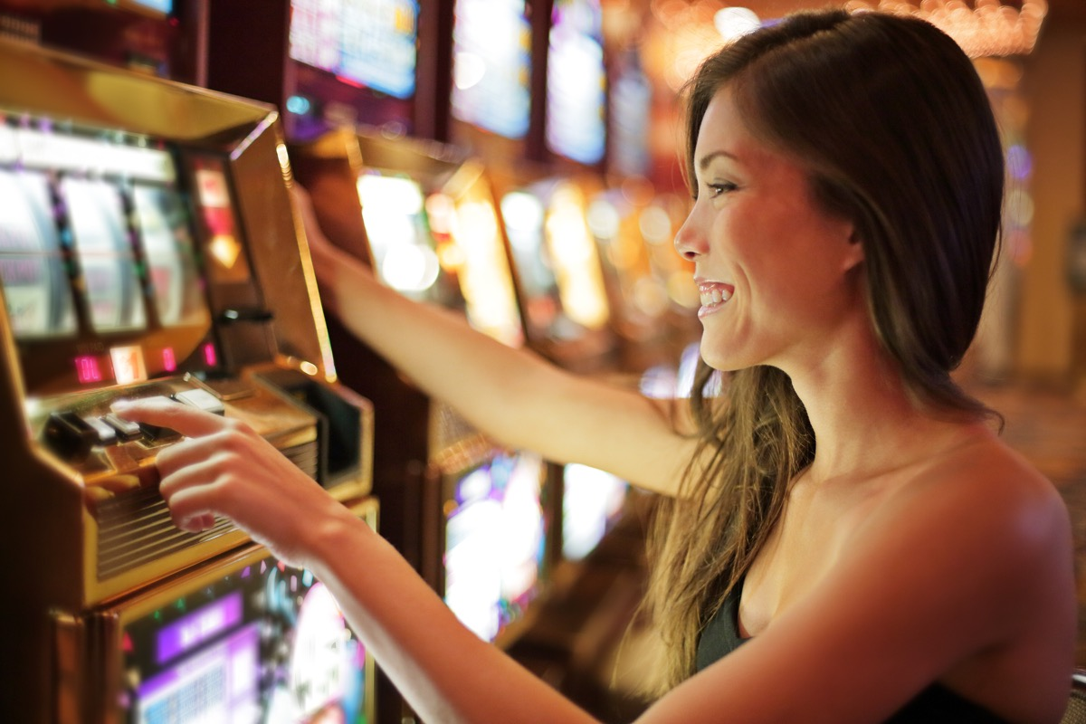 woman playing slot machines game cages worker jobs with high divorce rates