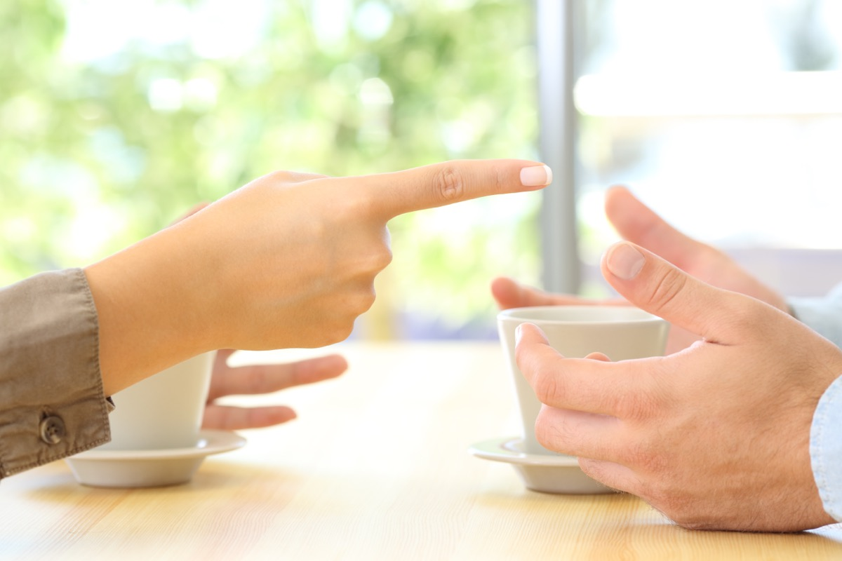close up of the hands of a couple arguing with woman pointing finger at man, things you should never say to your spouse