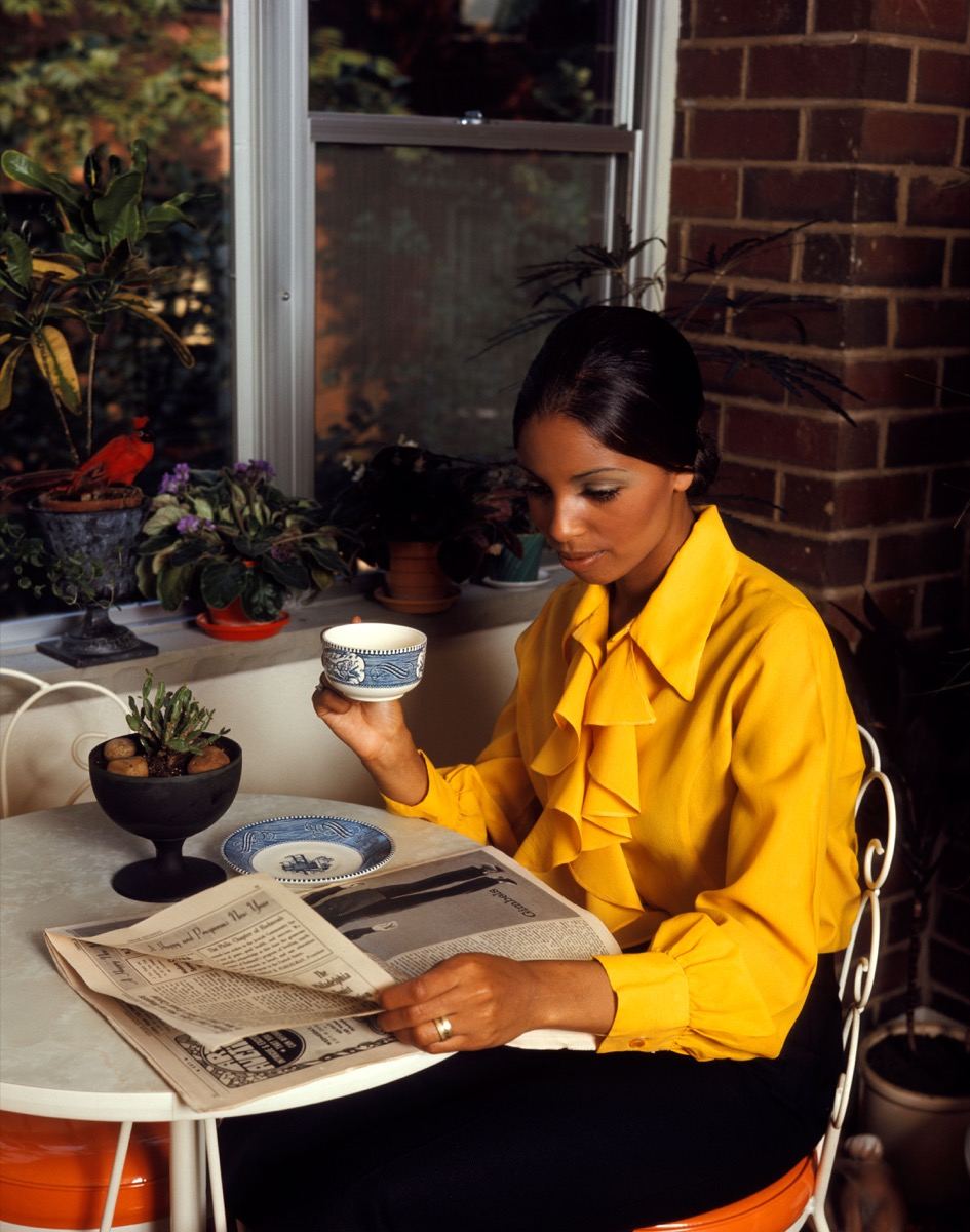 Woman in the 1970s Reading a Newspaper How People Used to Flirt