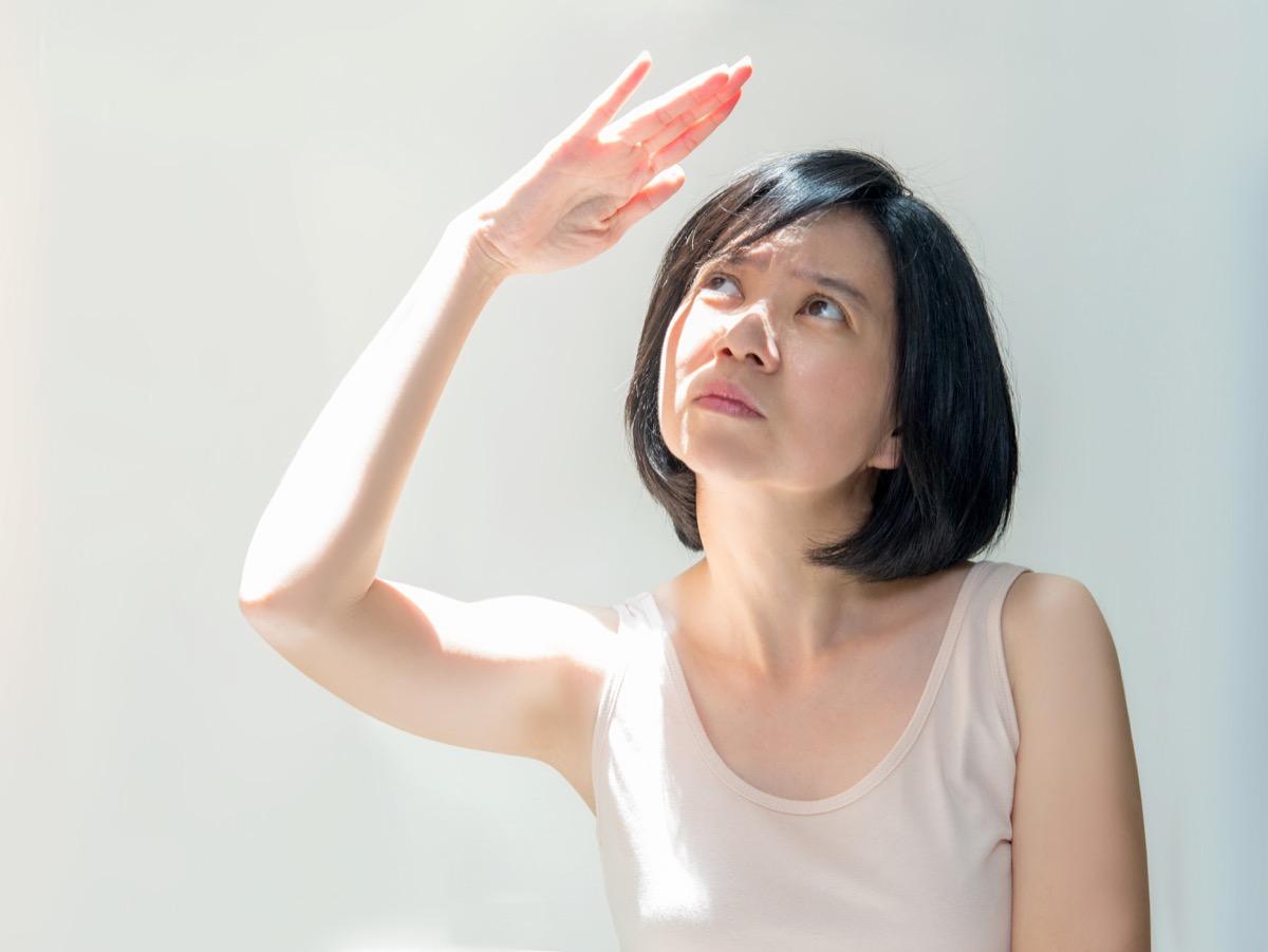 Woman Shielding Herself From Light Surprising Symptoms