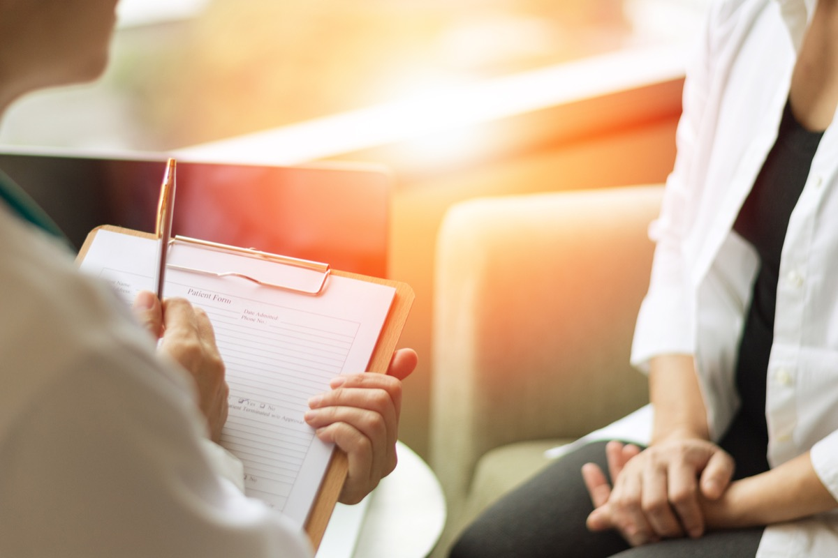 Woman Sitting Down Talking to Her Doctor Stop Lying to Your Doctor