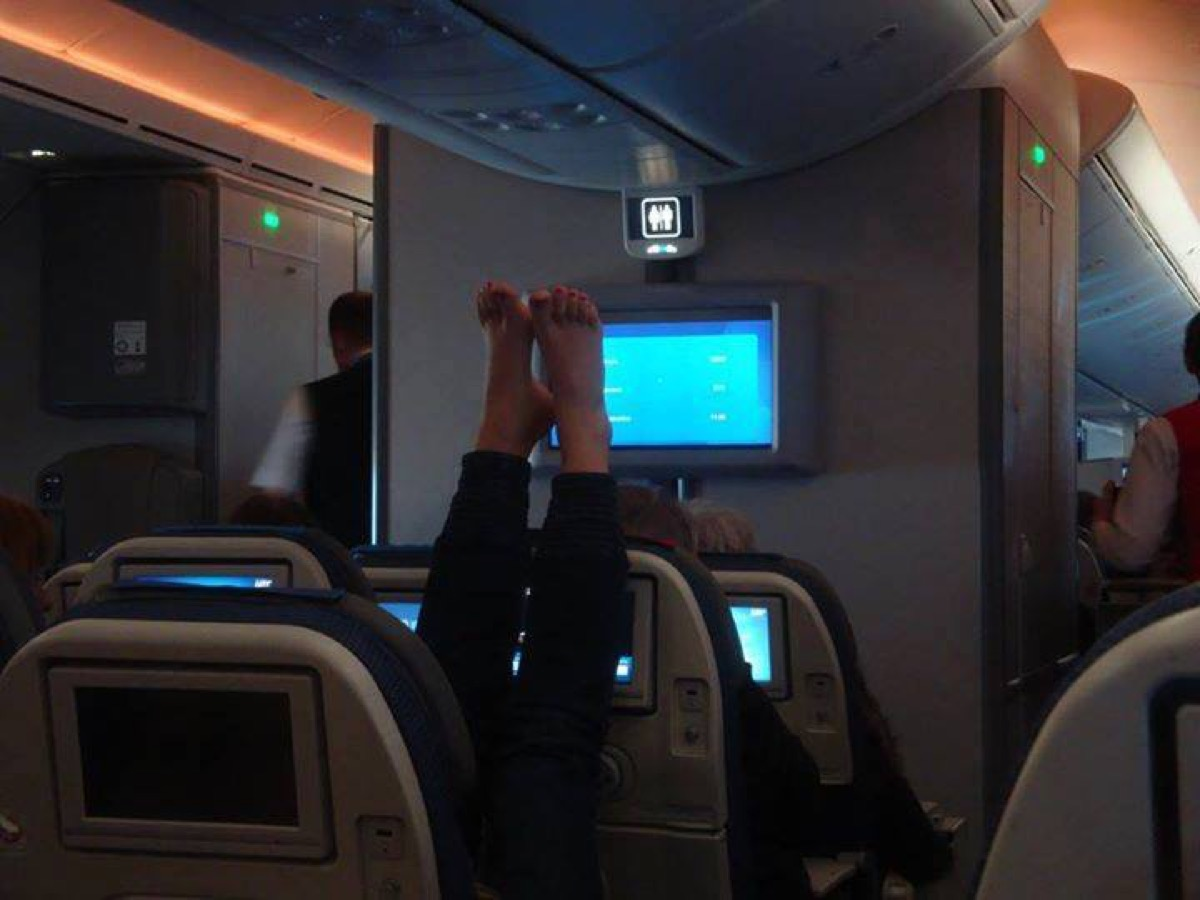 Woman with feet up on airplane photos of terrible airplane passengers