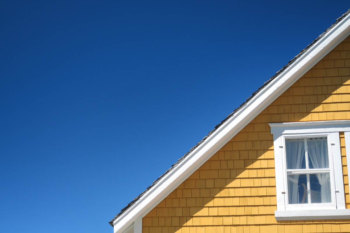 yellow home exterior which part of the roof shown