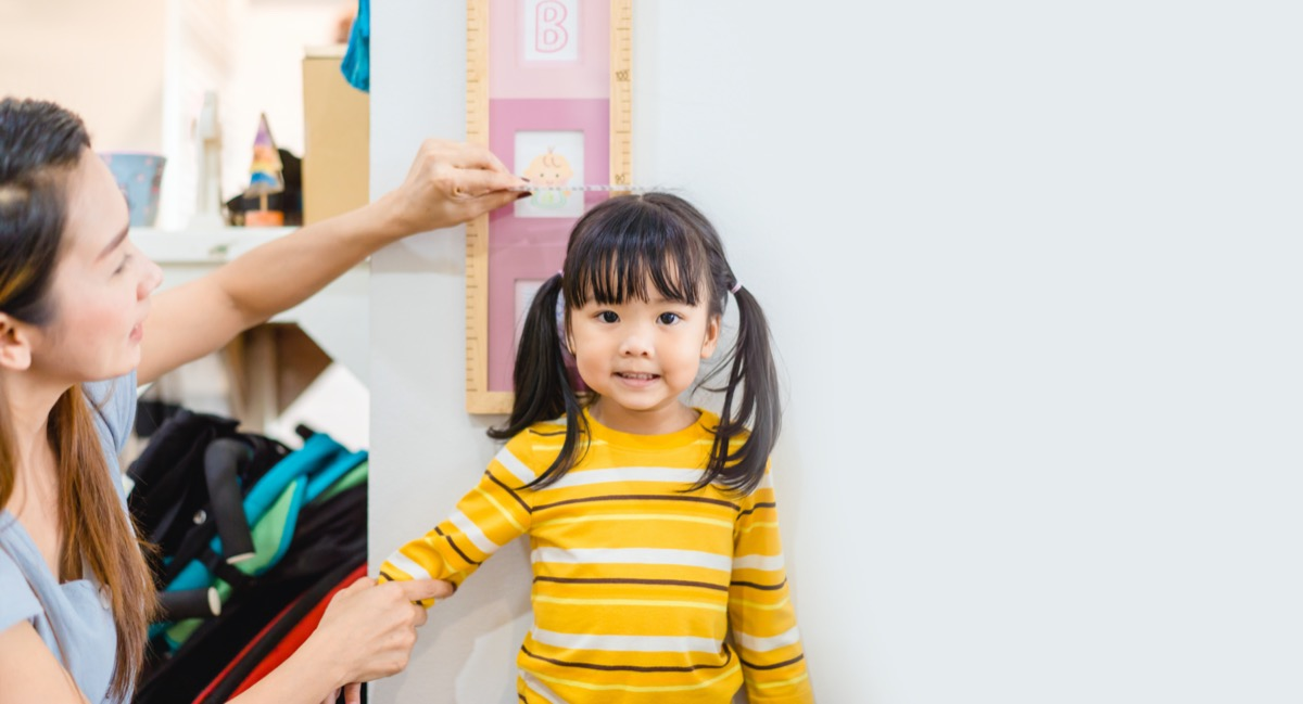 young asian child getting measured