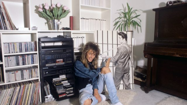 woman in the 1980s near her entertainment and tv center