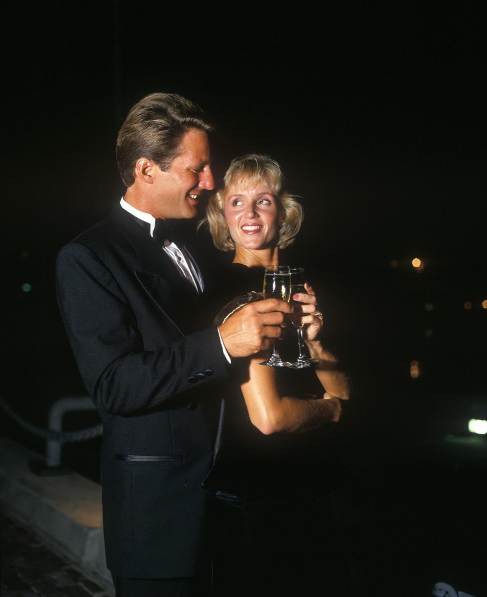 1990s couple enjoys champagne
