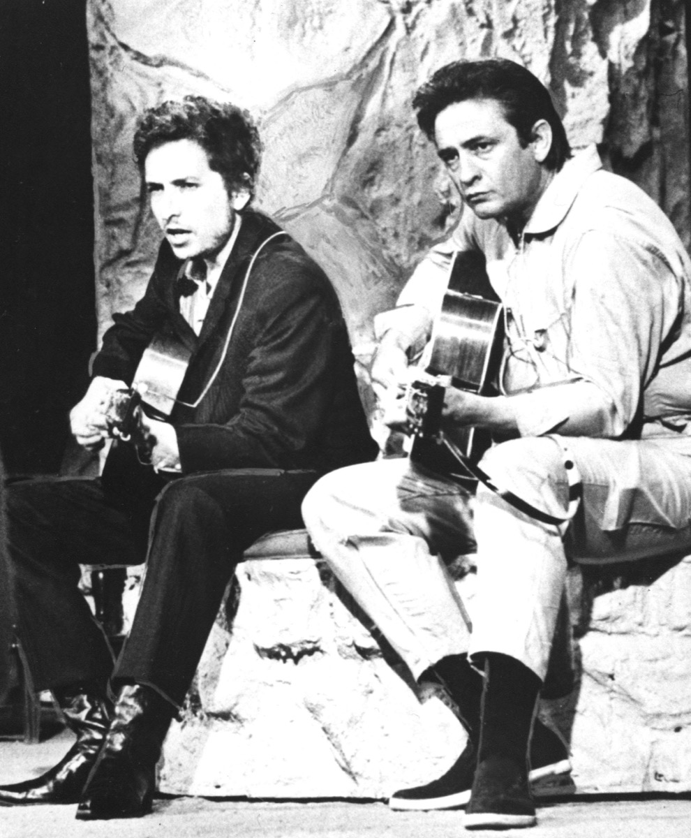 Bob Dylan and Johnny Cash sit on stage together and perform in 1969, songs turning 50