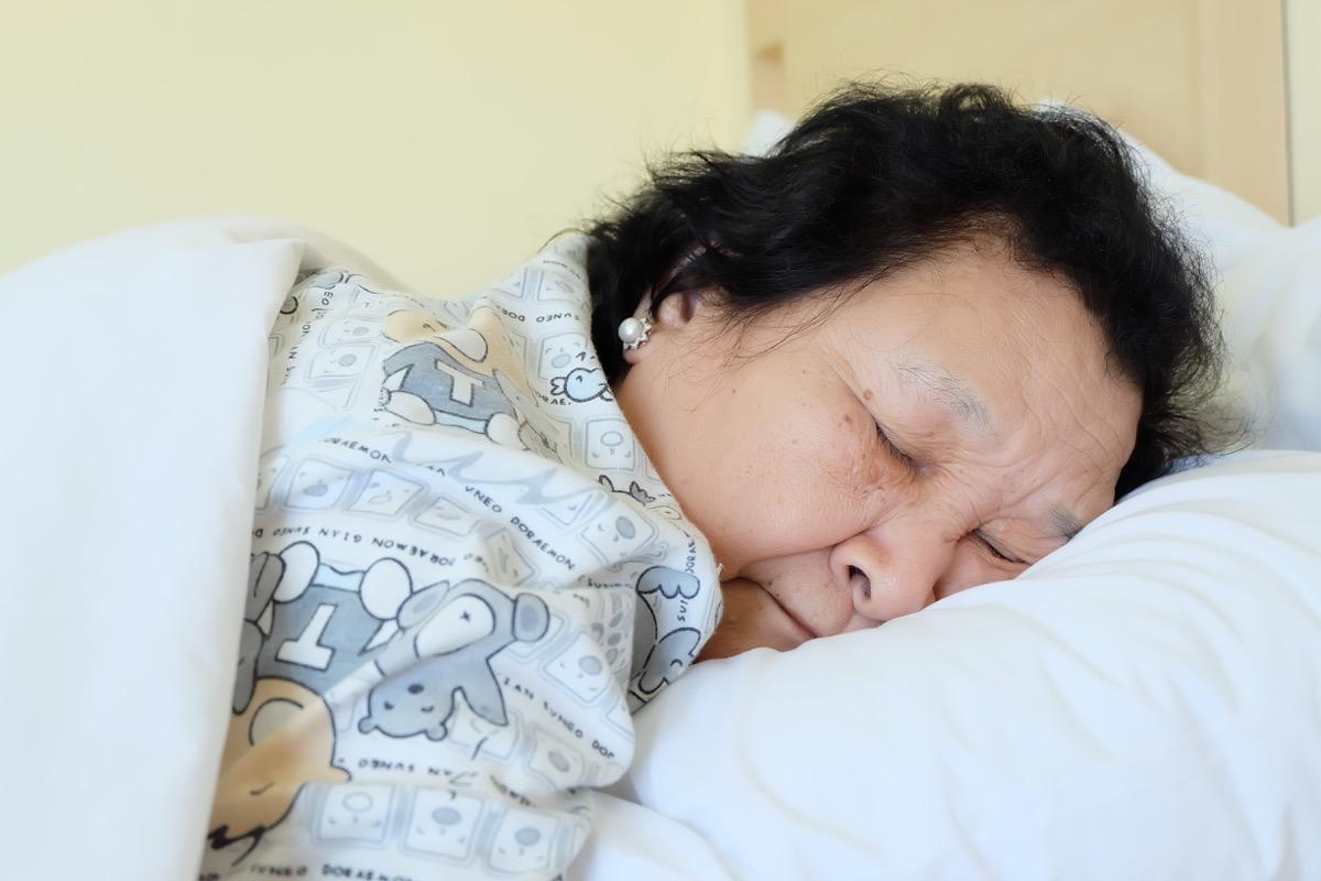 older woman sleeping, subtle symptoms of serious disease