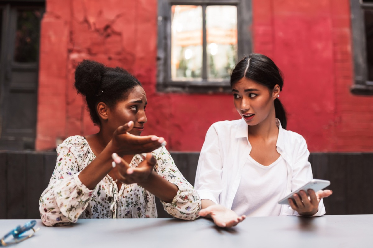 women talking outside, things you should never say to your spouse