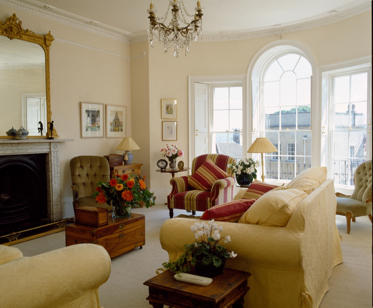 Cream sofa in townhouse sitting room with an arched window