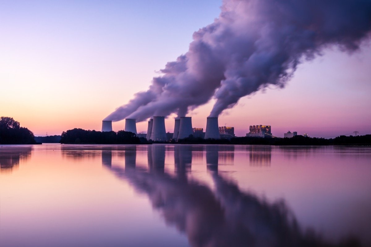 power Plant in the sunrise leaking fumes, carbon dioxide, earth day charities