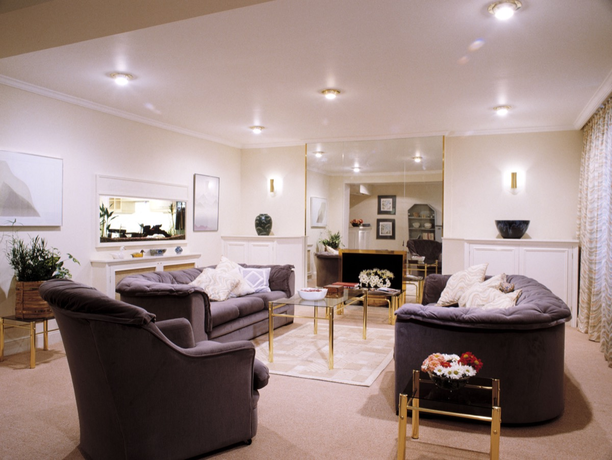 AHT19E Gray sofas and armchair in modern white living room with spotlights on false ceiling