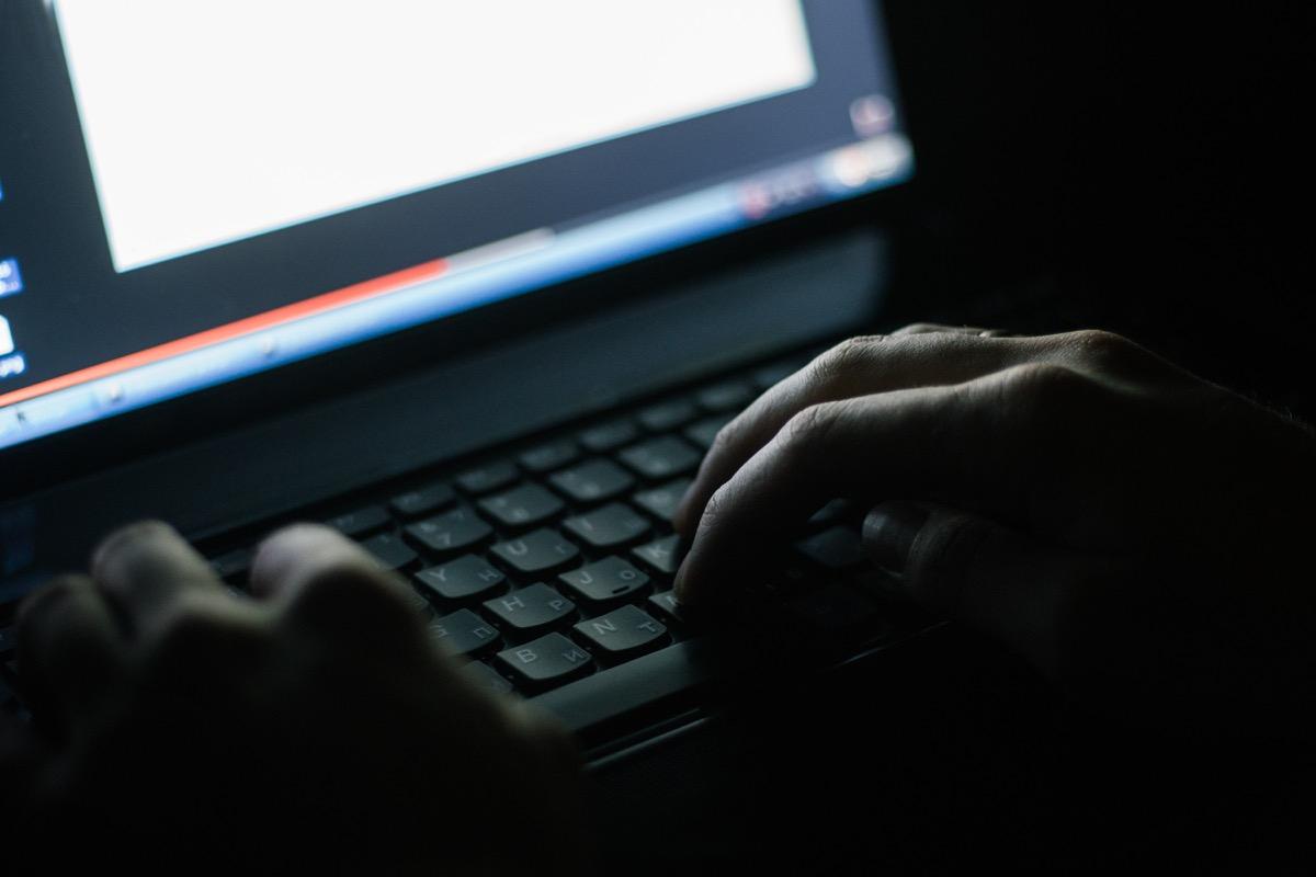 dark web man typing on keyword steeling password