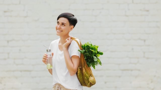 Eco-friendly woman with reusable items