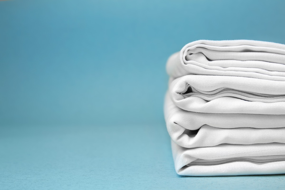 folded sheets laying on the floor, things you shouldn't store in your basement