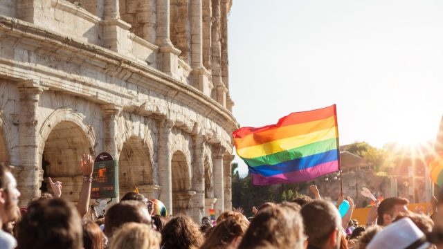 People Holding a Gay Pride Flag How to Support the LGBT Community stereotypes about the LGBTQ community