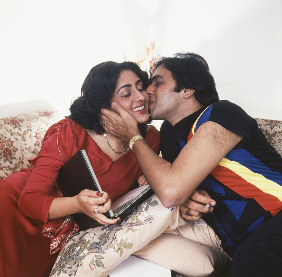 Indian Couple Kissing on the Cheek Cost of a Date