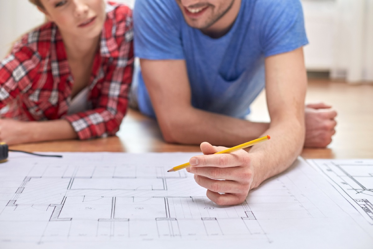 couple looking at blueprint worst home upgrades