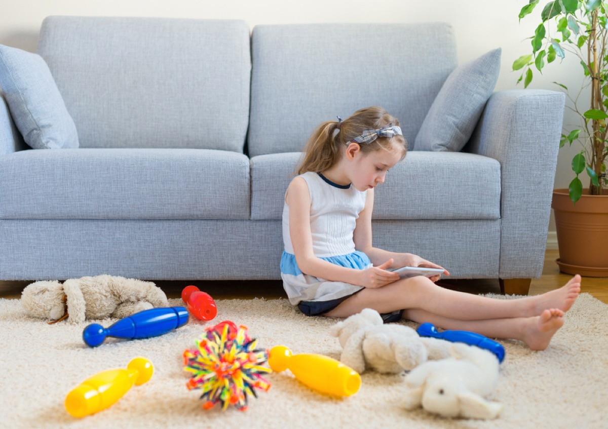 girl in playroom with toys, bad parenting