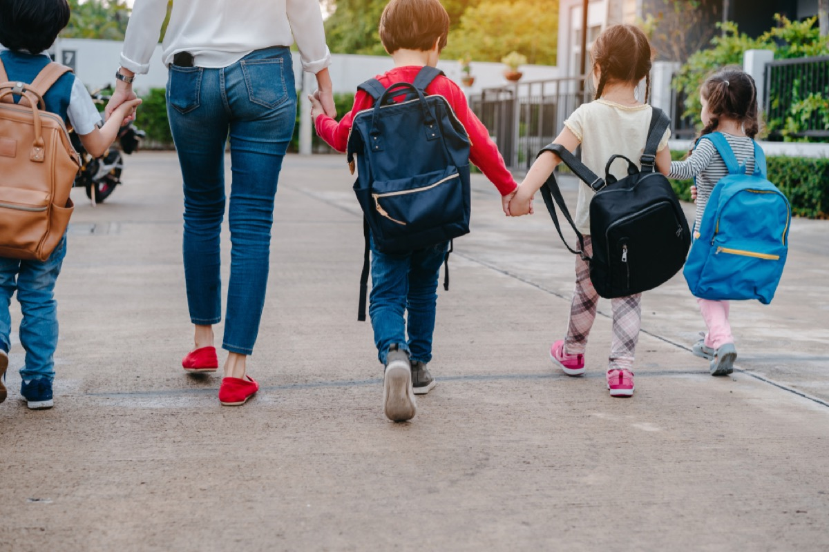 woman walking children to school, stay at home mom