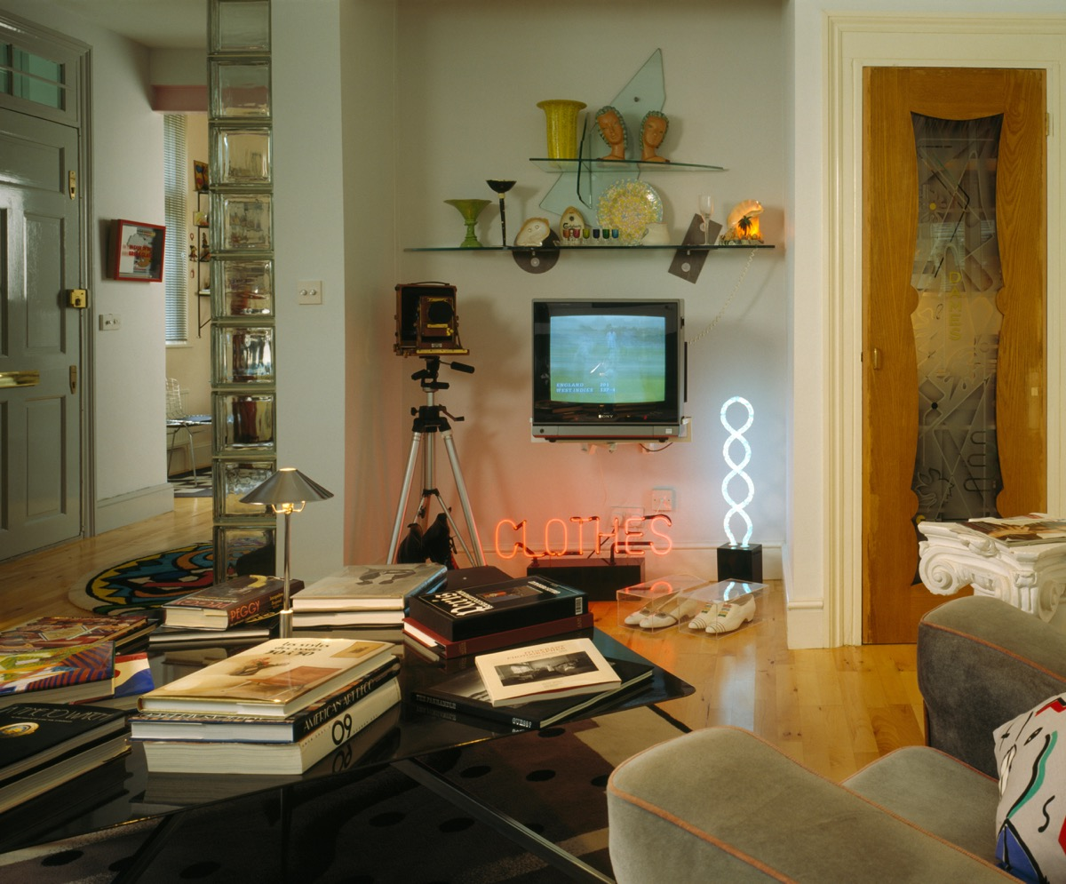 Neon lighting and portable television in nineties living room