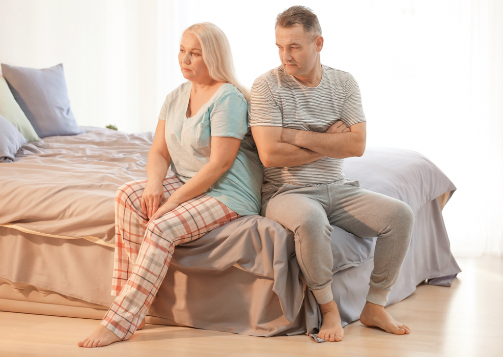middle aged couple having an argument in their bedroom, better wife after 40