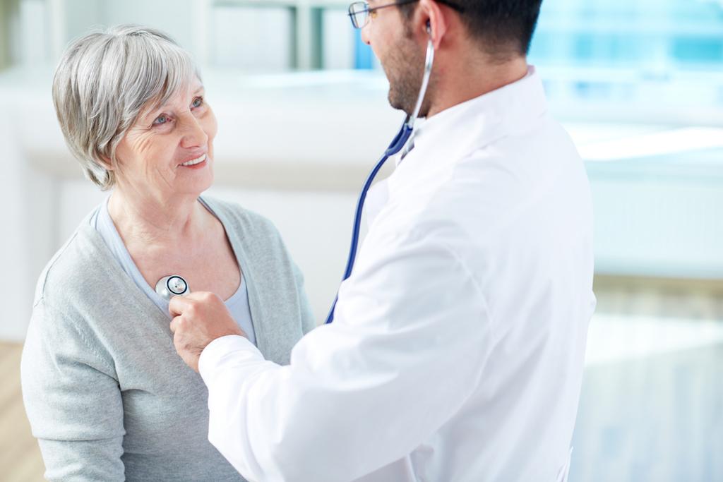elderly woman talking to male doctor