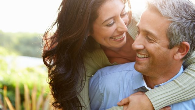 happy middle-aged couple full of optimism, long marriage tips